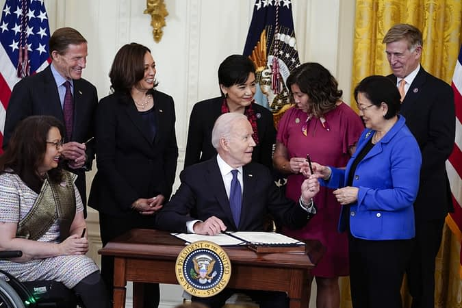 Biden signs law to combat hate crimes against Asian Americans